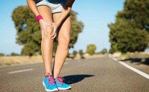 Runner on road feeling knee pain