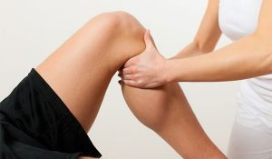 man with knee pain getting physio