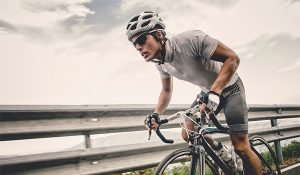 athletic cyclist biking outdoors