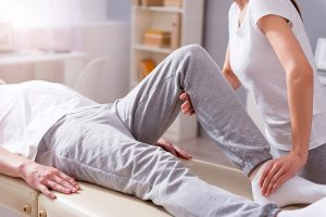 Man getting rehab at physio after surgery